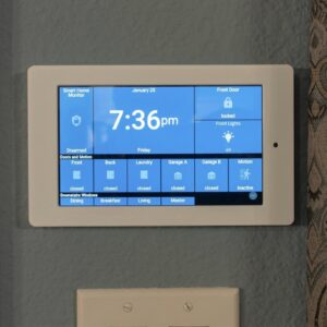 An Amazon Fire HD 10 running Home Assistant mounted on a wall